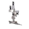 Una sonda di distribuzione del campione radiale progettata come hub centrale per servire più camere di attività.